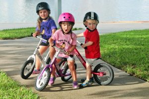 Kids learning to ride a bike.