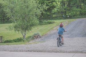 Kid biking on his own.